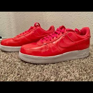 Red/pink Air Force 1s reflective